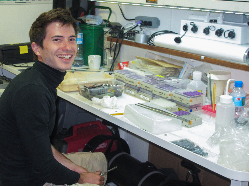 Erwan Delrieu-Trottin worining in the lab aboard the Golden Shadow.