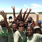 Students at Abaco Central High School and our Director of Education, Amy Heemsoth (center) celebrate restoring the mangrove ecosystem at Camp Abaco.