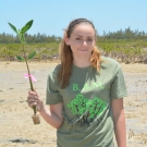 Forest Heights Academy student plants her last seedling.