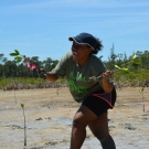 Even after sinking in the mud, this Forest Heights Academy student is excited to plant her mangroves.