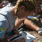 BAM participant from Forest Heights Academy draws a red mangrove leaf in her student journal.