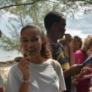 Students from Forest Heights Academy taste a black mangrove leaf. Even though it has been raining a lot, the students find out that the leaves are still very salty!