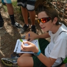 Forest Heights Academy student draws a black mangrove leaf and labels the salt and fine hairs on the leaf.