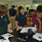 NOAA Knauss Fellow, Symone Johnson helping students at Forest Heights to use a GPS device.