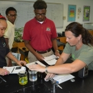 Our Director of Education, Amy Heemsoth shows students how to test the pH of various types of liquids.