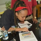 During the second year B.A.M. program, students will test several non-living factors in their mangrove plots. Here students are practicing using pH test strips.