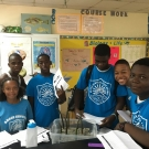 Biology students at Abaco Central High School are proud to plant their seedlings in mangrove mud.