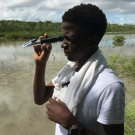 B.A.M. second year student reads the salinity of the mangrove ecosystem using a refractometer.