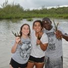 4.	Students from Forest Heights Academy show off the mangrove propagules they have collected for their class project.