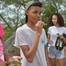6.	Students taste the mangrove leaves they collected (they're salty!).