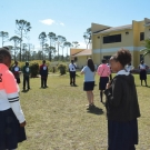 Students in the year one B.A.M. program at Abaco Central High School form a giant food web. Each student respresents an organism from the mangrove food web.