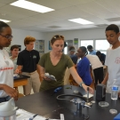 Partner from North Carolina State University, Ryann Rossi helps students to set up and sterilize their station.
