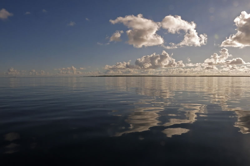 Glassy seas make for smooth sailing between survey sites.