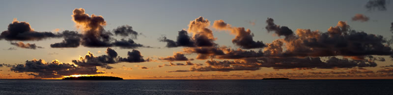 Panoramic sunset over the Three Brothers Islands on the western edge of the Great Chagos Bank.