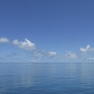 Glassy calm seas make for happy scientists in the Chagos Archipelago.