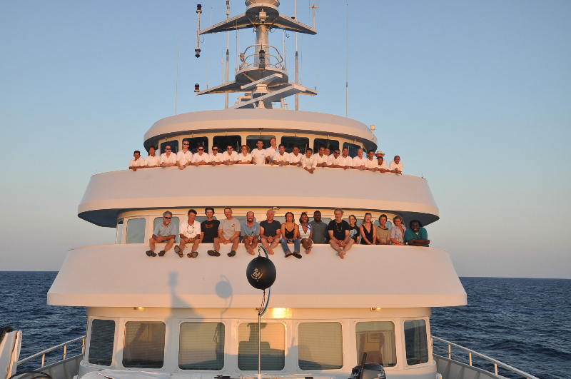 The Science Team and Crew on the Golden Shadow at sunset.