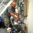 Timothy Payne II prepares tanks for a dive.