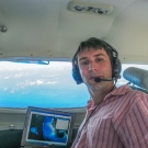 Dr. Sam Purkis doing an Aerial Survey on the Golden Eye.