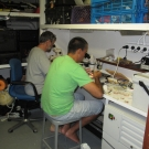 Members of the science team work in the lab aboard the M/Y Golden Shadow.