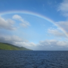 A beautiful rainbow stretching across one of the islands of Fiji.
