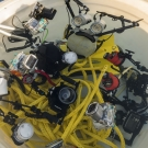 Scientists rinse off their underwater cameras in fresh water bin after diving on the Great Barrier Reef.