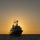 The Golden Shadow at sunset, the mothership of the Living Oceans Foundation. The ship is owned by His Royal Highness Prince Khaled bin Sultan.
