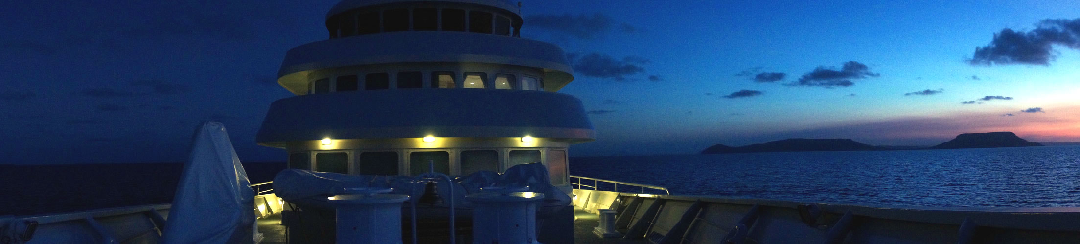 Panoramic view of the foredeck of the Shadow at dusk.