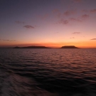 Sunset over the Great Barrier Reef at the end of a long survey day.