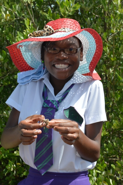 This Jamaican high school student is so excited to hold a crab for the first time as part of the Jamaican Awareness of Mangroves in Nature (JAMIN) project.