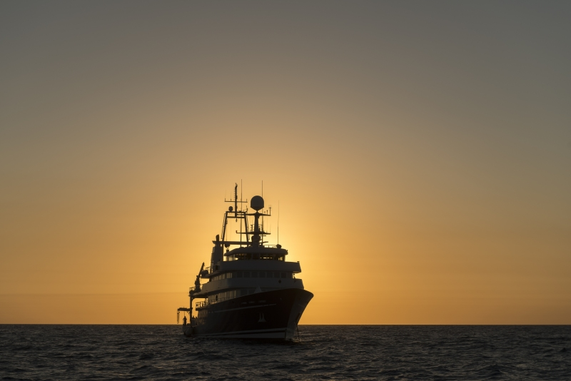 Anchored Golden Shadow against sunset. Golden Shadow, the mothership of the Living Oceans Foundation. The ship is owned by Khaled bin Sultan.