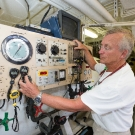 Doctor David Skinner at the controls of the hyperbaric chamber on board the M/Y Golden Shadow.