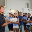 Dr. Andrew Bruckner showing coral to Polynesian students.