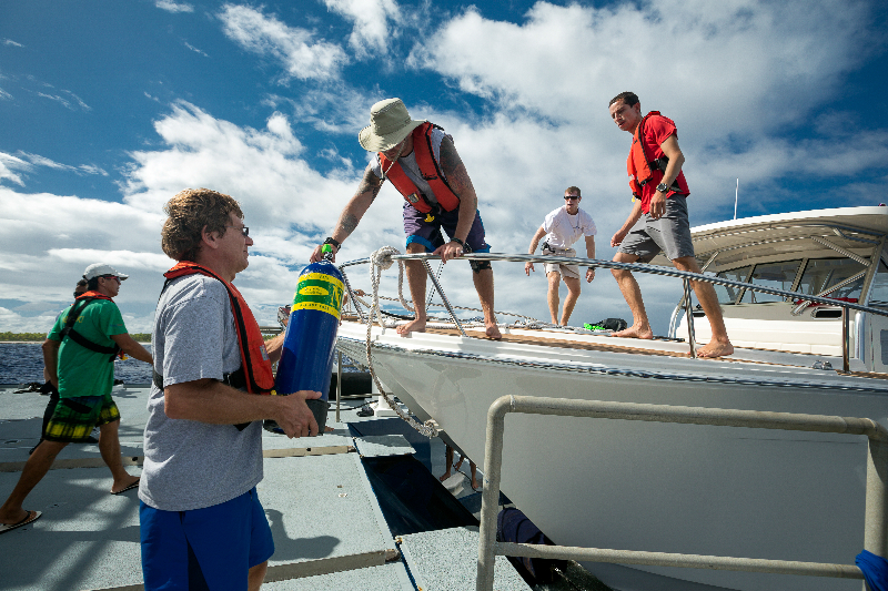 Dr. Andrew Bruckner, the science team and staff load SCUBA equipment onto the Calcutta.
