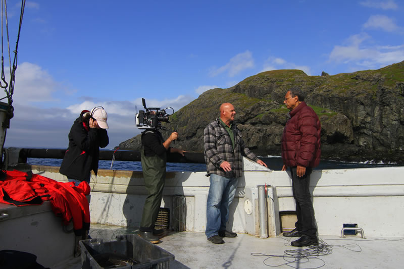 Fisheries scientist Dr. Daniel Pauly talks to fisherman Carl Hedderson about his catch