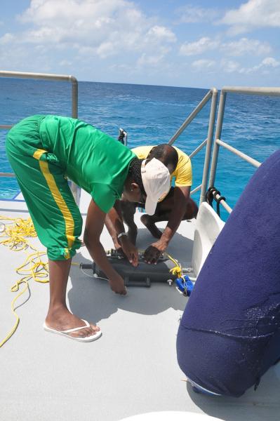 Azra Blythe-Mallett and Sean Green prepare surveying equipment.