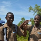 The boys show off a fiddler crab they found in the mangroves.