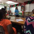 Director of Education, Amy Heemsoth teachers students at Marcus Garvey about the three main adaptations of mangroves: reproduction, anaerobic sediment, and living in salt water.