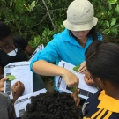 Students from Marcus Garvey put STEAM into action as they draw and label the different species of mangrove leaves. Director of Education, Amy Heemsoth helps to guide this process.