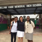 Shanna Thomas (Outreach Officer, University of the West Indies), Amy Heemsoth (Director of Education, Living Oceans Foundation), and Fulvia Nugent (Science Teacher, William Knibb High School) stand at the entrance of the school.