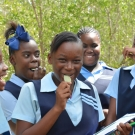 Students taste a mangrove leaf -they\'re salty!