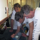 Andrew Bruckner, Brian Beck, and Phil Renaud read information gatherd from a meter on the previous dives.