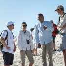 Daniel Pauly, Martin Visbeck, and Robbert Cassier speak with a Galápagos park guide. (© Andreas Krueger/UNESCO)