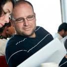 Alison Barrat talks to Dr. Stephen Box. (© Andreas Krueger/UNESCO)