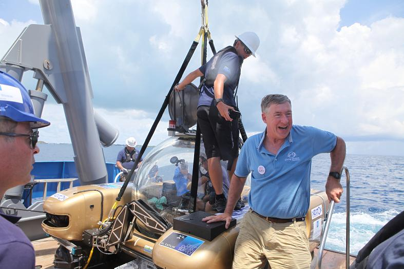 "Captain Philip G. Renaud celebrates a successful dive, and a successful launch of ""World Heritage in the High Seas: An Idea Whose Time has Come.\"""