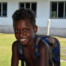 A young boy in Bareho Village is excited to start school.
