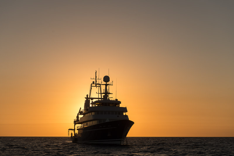Anchored Golden Shadow against sunset. Golden Shadow, the mothership of the Living Oceans Foundation. The ship is owned by Khaled bin Sultan. © Jürgen Freund/LOF
