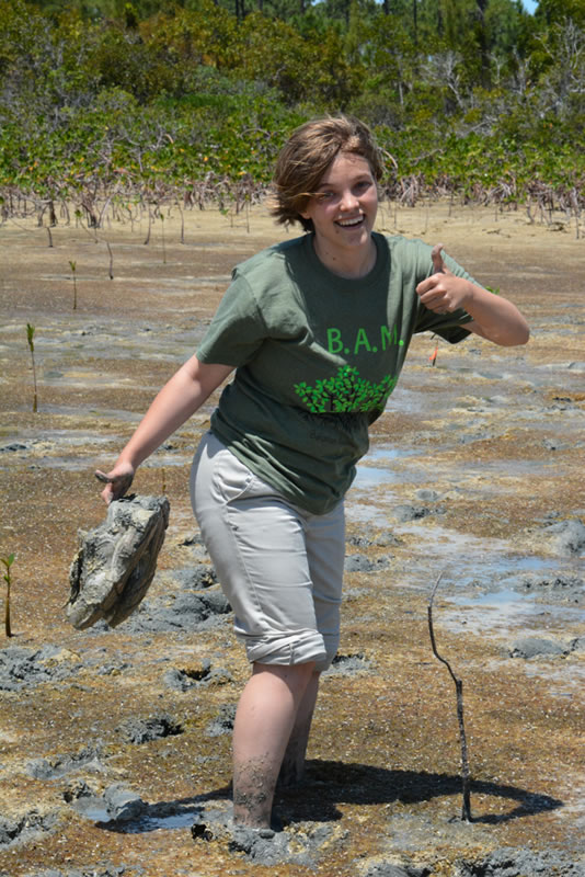 Even though this Forest Heights Academy student was hesitant about walking in the mangrove mud, she did it anyway and with a smile on her face!