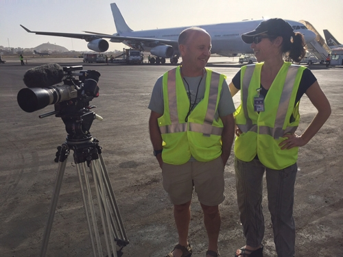 Executive Producer of The Missing Catch chats with cameraman Doug Allan about filming the export of fish at Dakar airport.