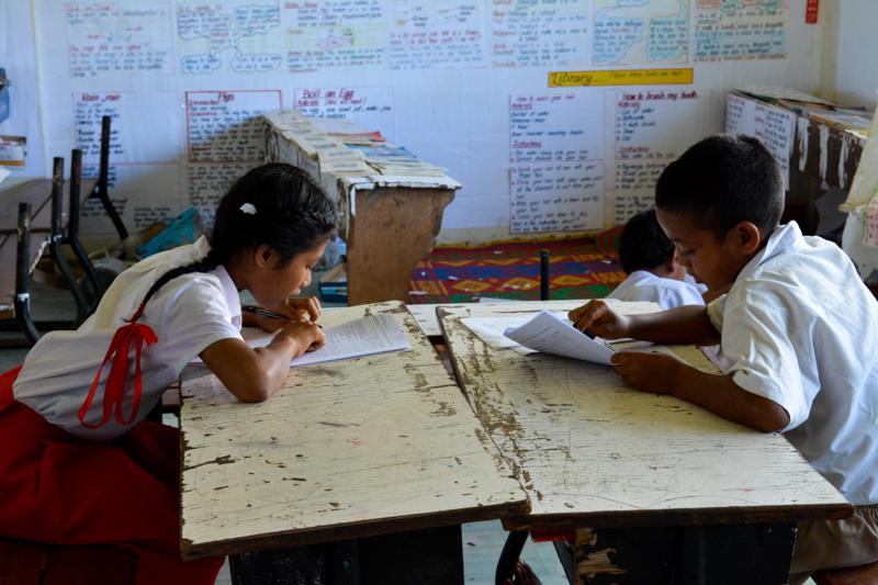 GPS Koloa students taking survey about coral reefs.