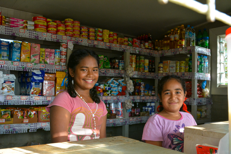 Girls tending to a local food stand.